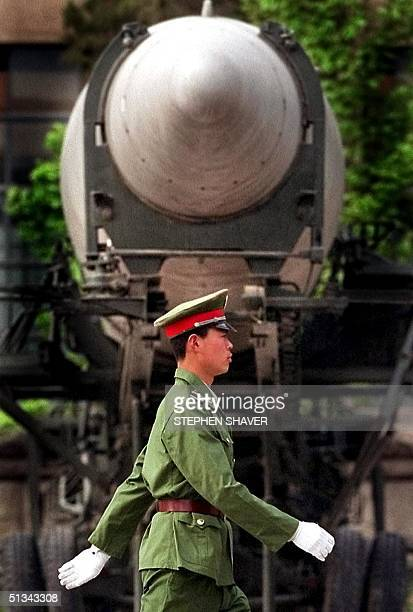 Chinese People's Liberation Army soldier walks past a mediumrange ballistic missle on display at Beijing's Military Museum which showcases China's...