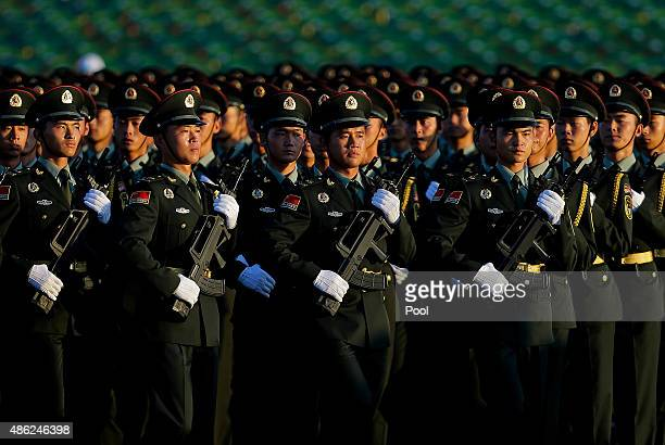 Chinese People's Liberation Army troops practice marching as they arrive at Tiananmen Gate for a military parade to commemorate the 70th anniversary...