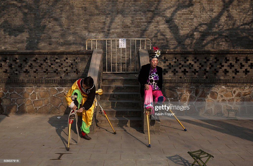 Chinese performer wearing stilts wait before performing at a local fair during Spring Festival celebrations on February 10, 2016 in Beijing, China. The Chinese Lunar New Year also known as the Spring Festival, which is based on the Lunisolar Chinese calendar, is celebrated from the first day of the first month of the lunar year and ends with Lantern Festival on the fifteenth day. This new year marks the Year of the Monkey.