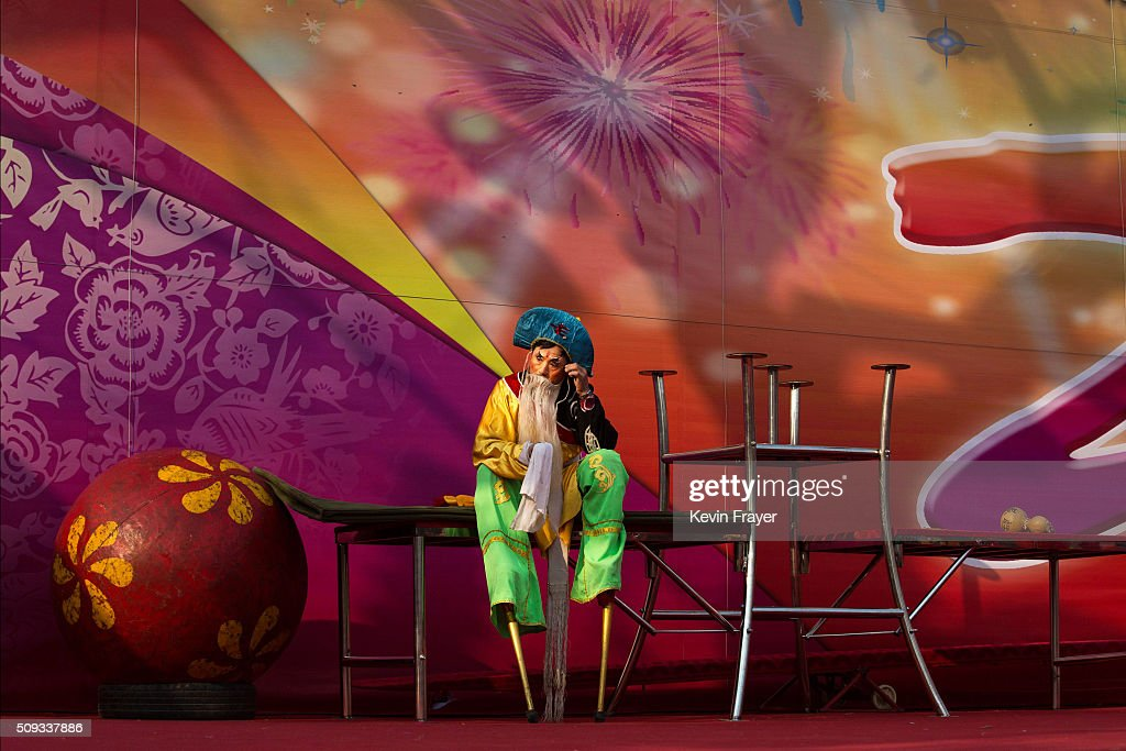 A Chinese performer wearing stilts waits to perform at a local fair during Spring Festival celebrations on February 10, 2016 in Beijing, China. The Chinese Lunar New Year also known as the Spring Festival, which is based on the Lunisolar Chinese calendar, is celebrated from the first day of the first month of the lunar year and ends with Lantern Festival on the fifteenth day. This new year marks the Year of the Monkey.