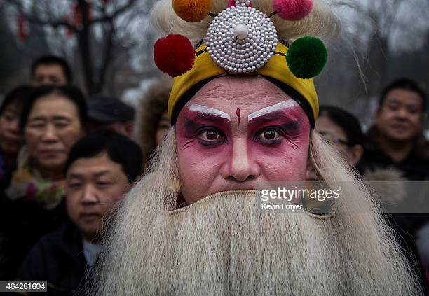 Chinese performer wears a beard and costume as he waits to perform in Spring Festival celebrations at a Temple Fair on February 21 2015 in Beijing...