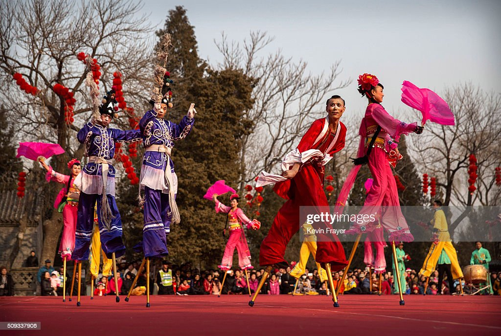 Chinese performers dance on stilts at a local fair during Spring Festival celebrations on February 10, 2016 in Beijing, China. The Chinese Lunar New Year also known as the Spring Festival, which is based on the Lunisolar Chinese calendar, is celebrated from the first day of the first month of the lunar year and ends with Lantern Festival on the fifteenth day. This new year marks the Year of the Monkey.