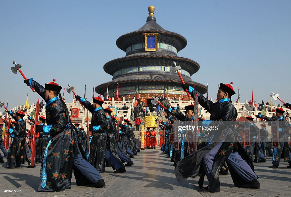 Chinese performers reenact a traditional Qing Dynasty ceremony in which emperors prayed for good fortune at the Temple of Heaven in Beijing on...