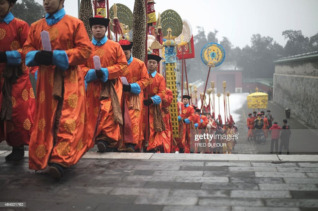 Chinese performers reenact a traditional Qing Dynasty ceremony in which emperors prayed for good fortune at the Temple of Heaven as part of the...