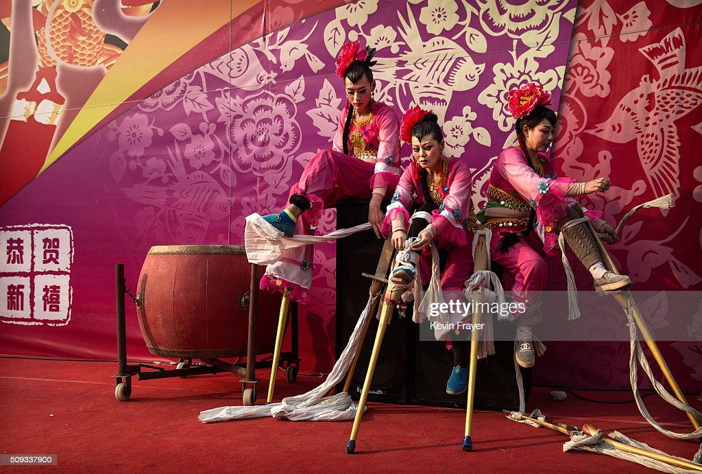 Chinese performers take off their stilts after their a performance at a local fair during Spring Festival celebrations on February 10, 2016 in Beijing, China. The Chinese Lunar New Year also known as the Spring Festival, which is based on the Lunisolar Chinese calendar, is celebrated from the first day of the first month of the lunar year and ends with Lantern Festival on the fifteenth day. This new year marks the Year of the Monkey.