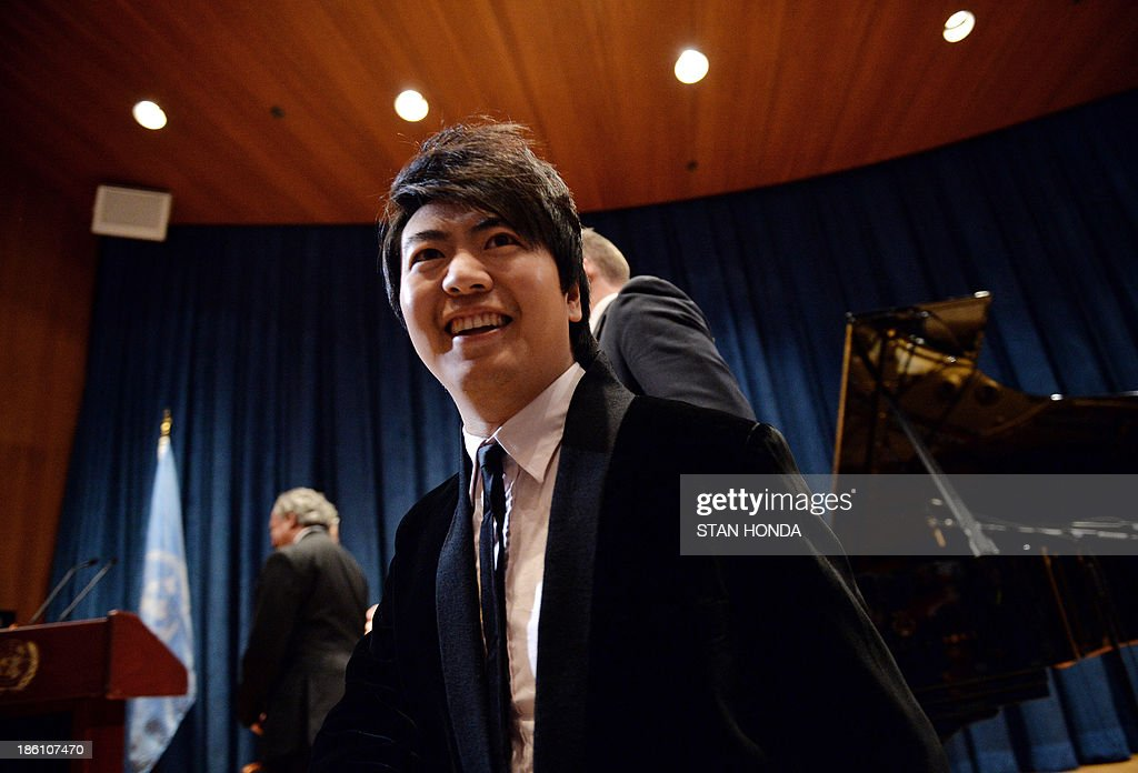 Chinese pianist Lang Lang arrives just before being named a United Nations Messenger of Peace October 28, 2013 at UN headquarters in New York. Lang Lang said Monday he is ready to play in a conflict zone as he was named a UN messenger of peace. The 31-year-old virtuoso said he was 'truly humbled' to become a UN messenger alongside the likes of actors George Clooney and Charlize Theron and Nobel laureate Elie Wiesel. Lang Lang played the waltz for UN leader Ban Ki-moon to mark his new job and was then asked whether he would be ready to go to Syria or another danger zone. 'When the time comes, I would love to do it,' said Lang Lang, who will concentrate on spreading education in his new role. AFP PHOTO/Stan HONDA