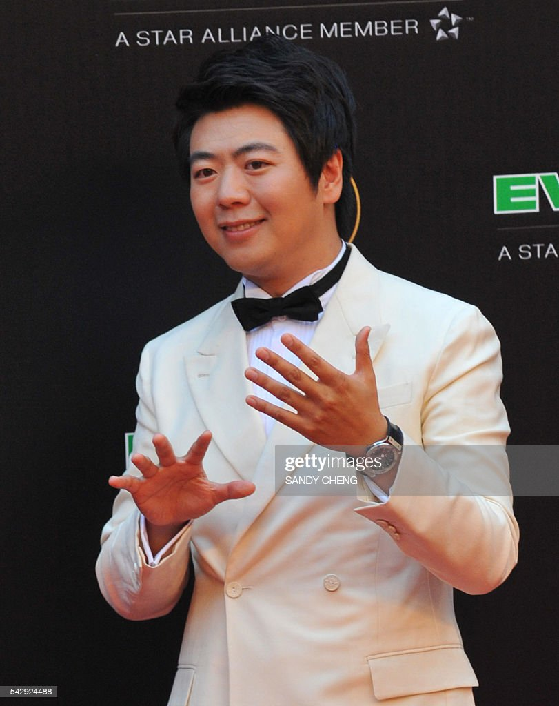 Chinese pianist Lang Lang arrives to attend the 27th Golden Melody Awards in Taipei on June 25, 2016. Some of Mandarin pop's biggest names have gathered for the annual Golden Melody music awards, with singers, songwriters and composers from Taiwan, China, Hong Kong, Singapore and Malaysia competing in more than 20 categories. / AFP / SANDY