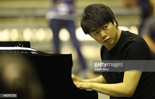 Chinese Pianist Lang Lang directs pianoplaying children during a rehearsal on June 13 2012 in Berlin Germany Lang will be celebrating his 30th...