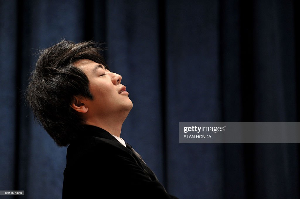 Chinese pianist Lang Lang finishes performing Chopin's 'Waltz No. 1' after being named a United Nations Messenger of Peace October 28, 2013 at UN headquarters in New York. Lang Lang said Monday he is ready to play in a conflict zone as he was named a UN messenger of peace. The 31-year-old virtuoso said he was 'truly humbled' to become a UN messenger alongside the likes of actors George Clooney and Charlize Theron and Nobel laureate Elie Wiesel. Lang Lang played the waltz for UN leader Ban Ki-moon to mark his new job and was then asked whether he would be ready to go to Syria or another danger zone. 'When the time comes, I would love to do it,' said Lang Lang, who will concentrate on spreading education in his new role. AFP PHOTO/Stan HONDA