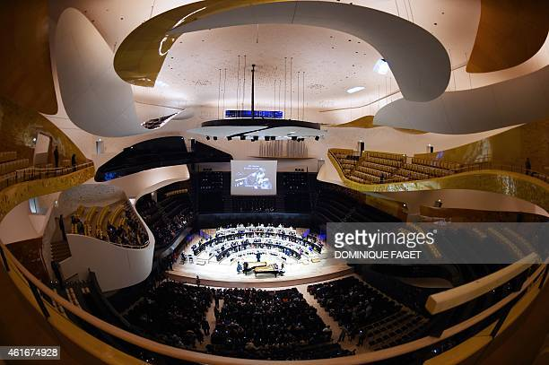 Chinese pianist Lang Lang performs accompanied by 101 young pianists during open house at the 'Philharmonie de Paris' concert hall in the Parc de la...