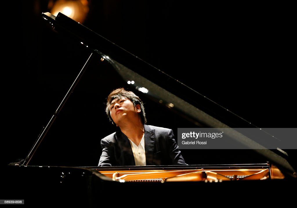 Chinese pianist Lang Lang performs during a show at Teatro Colon on August 13, 2016 in Buenos Aires, Argentina.