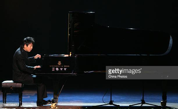 Chinese Pianist Lang Lang performs during his New Year Piano Solo Concert at the Chongqing People's Great Hall on December 21 2007 in Chongqing...