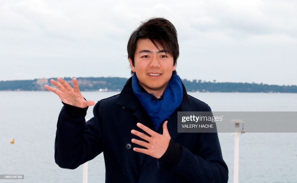 Chinese Pianist Lang Lang poses during a photocall as part of the music world's largest annual trade fair, Midem, on January 28, 2013 in Cannes, southeastern France. The Midem music trade show will bring 7,000 of the global industry's biggest players together on the French Riviera for four days.