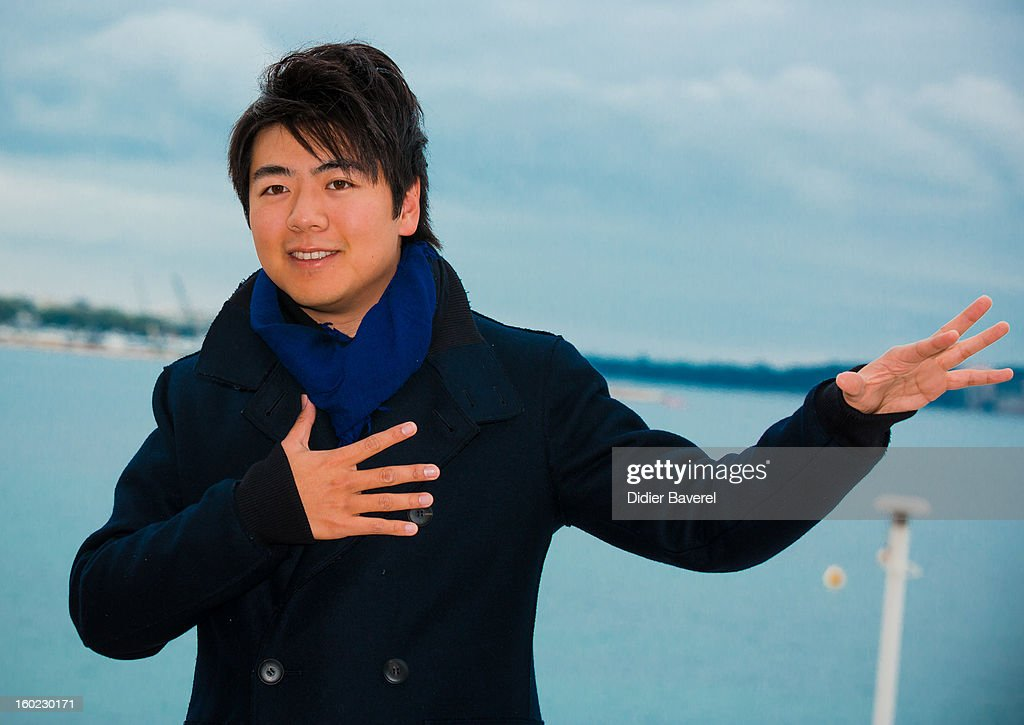 Chinese Pianist <a gi-track='captionPersonalityLinkClicked' href=/galleries/search?phrase=Lang+Lang&family=editorial&specificpeople=589153 ng-click='$event.stopPropagation()'>Lang Lang</a> poses during the photocall of 47th Midem at Palais des Festivals on January 28, 2013 in Cannes, France.
