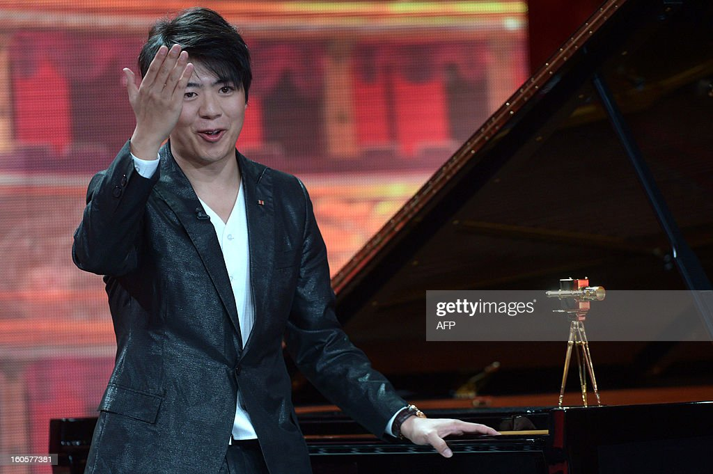 Chinese pianist Lang Lang waves to the audience after receiving his trophy for Category 'best music international'during the 48th Golden Camera awards ceremony in Berlin on February 2, 2013. The award of the Axel Springer Verlag publishing house honours outstanding achievements in television, film and entertainment.