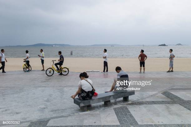Chinese plainclothes police stand by the shore next to the media centre for the BRICS Summit in Xiamen Fujian province on September 3 2017 The five...