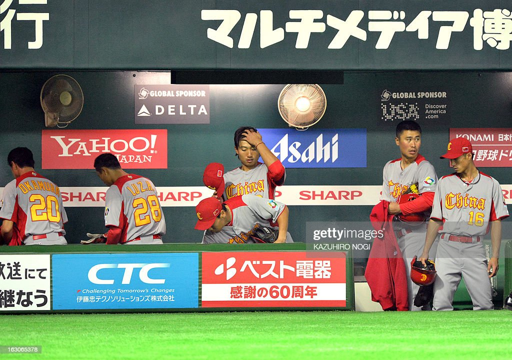 Chinese players leave after their losing match against Cuba at the first-round Pool A game in the World Baseball Classic tournament in Fukuoka on March 4, 2013. Cuba beat China 12-0 with a called game at the seventh inning.