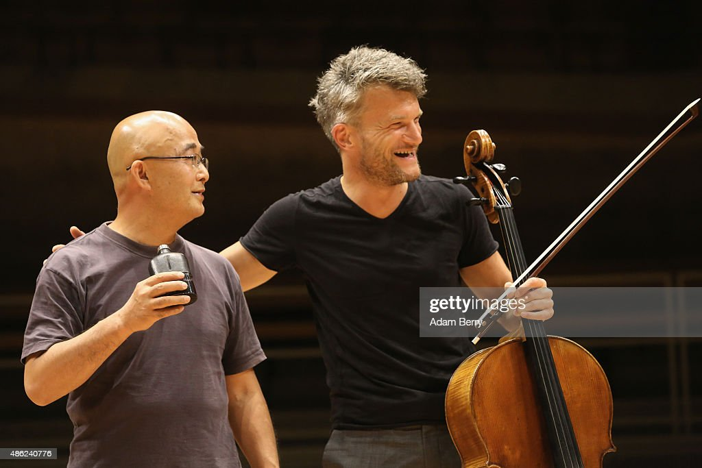 Chinese poet Liao Yiwu (L) has a drink while joking around with cellist Marcus Hagemann as he waits for the beginning of a panel discussion at the Berlin International Literature Festival on September 2, 2015 in Berlin, Germany. Chinese dissident artist Ai Weiwei and Liao participated in a conversation about literature, contemporary art, and their relationships with Chinese authorities. Liao had been imprisoned for four years in 1989, and in 2011, Ai was detained and beaten by security officials and then imprisoned for 81 days, only to reclaim his passport this past July, after which he went to Germany to meet his his partner Wang Fen and their son Ai Lao.