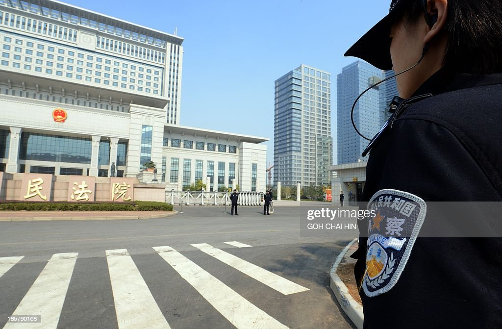 Chinese police guard the Shandong high court building in Jinan, east China Shandong province on October 25, 2013. A Chinese court rejected fallen politician Bo Xilai's appeal against his corruption conviction and confirmed his life sentence on October 25, as authorities looked to draw a line under a damaging scandal.