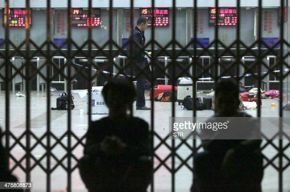 Chinese police investigators inspect the scene of an attack at the railway station in Kunming southwest China's Yunnan province on March 2 2014 A...