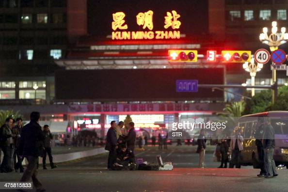 Chinese police investigators inspect the scene of an attack outside the railway station in Kunming southwest China's Yunnan province on March 2 2014...