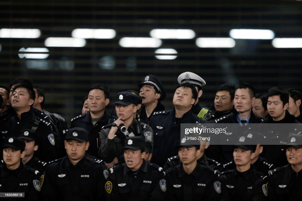 Chinese Police line up to watch the game during the AFC Champions League match between Jiangsu Sainty and Vegalta Sendai at Nanjing Olympic Sports Center Stadium on March 12, 2013 in Nanjing, China.