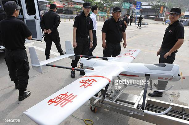 Chinese police load a unmanned drone aircraft as Beijing unveiled its 'first unmanned opium reconnaissance plane' which will conduct a monthlong...