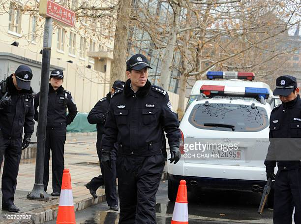 Chinese police man a checkpoint along a street as security is ramped up with at least 300 hundred uniformed police guarding the entrance to the...