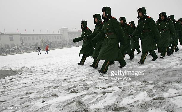 Chinese police march through a snowcovered Tiananmen Square on February 15 2005 in Beijing China Residents woke on February 15 to a sudden snowfall...