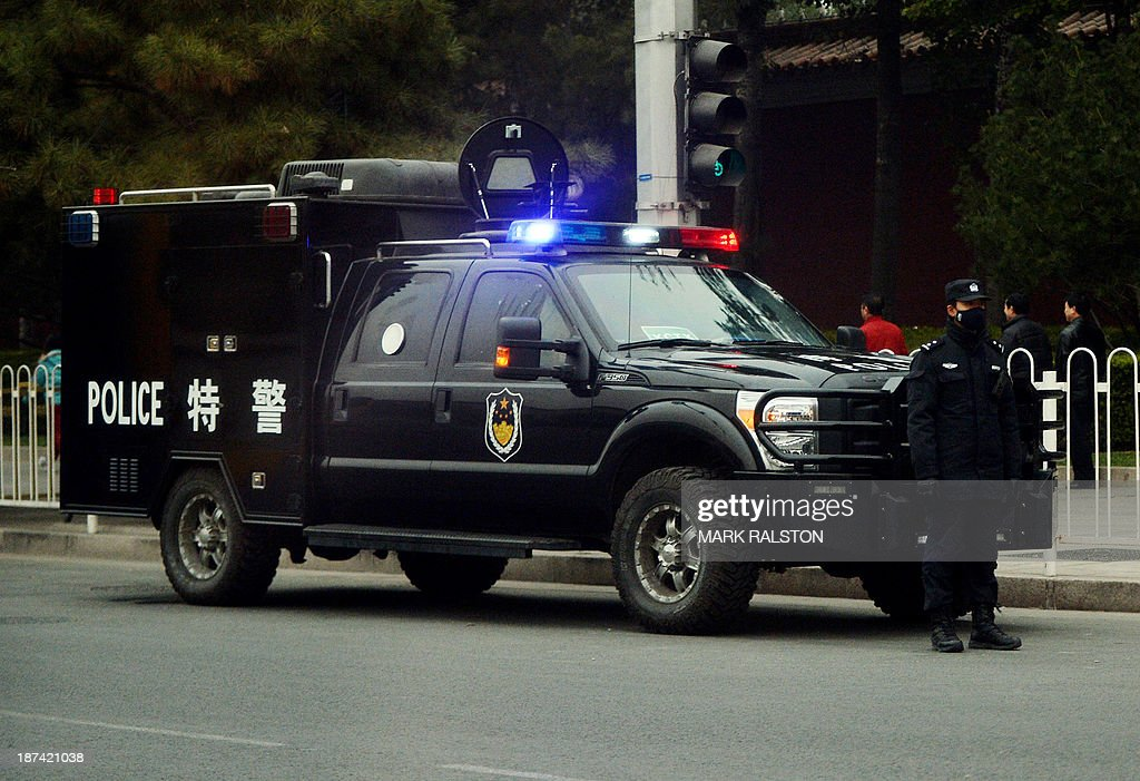 Chinese police monitor the access roads leading to the Jingxi Hotel which is the site of the Communist Party Central Committee's Third Plenum in Beijing on November 9, 2013. China's ruling Party started the key meeting which is expected to focus on economic reforms a year after a closely watched leadership transition. The four-day session of the full 376-member Communist Party Central Committee takes place at a closely guarded private hotel and traditionally sets the economic tone for a new government. AFP PHOTO/Mark RALSTON