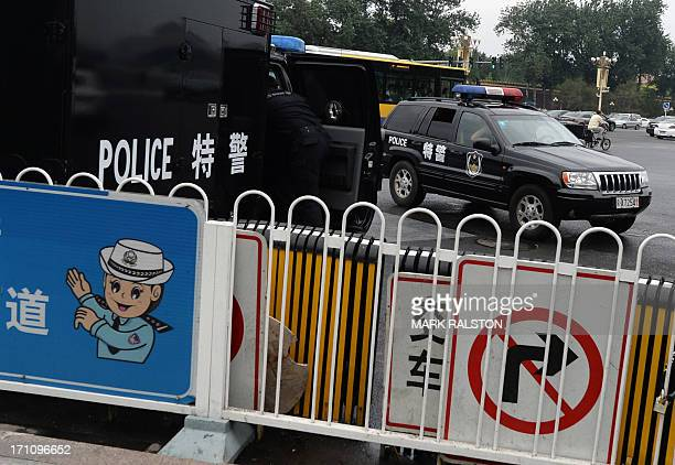 Chinese police monitor visitors to Tiananmen Square in Beijing on June 22 2013 Edward Snowden the young intelligence technician who leaked details of...