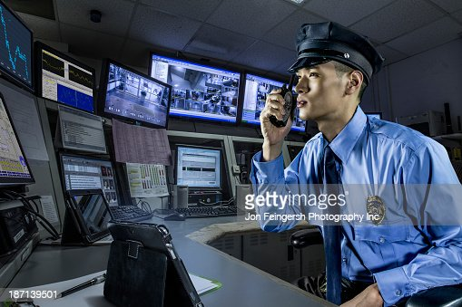 Chinese police officer working in control room : Stock Photo