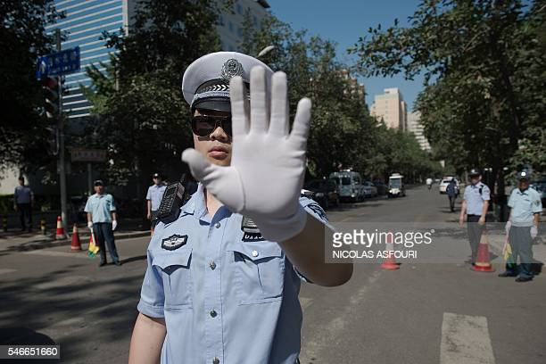 TOPSHOT Chinese police officers block the road leading to the Philippines embassy in Beijing on July 13 2016 the day after an international court on...