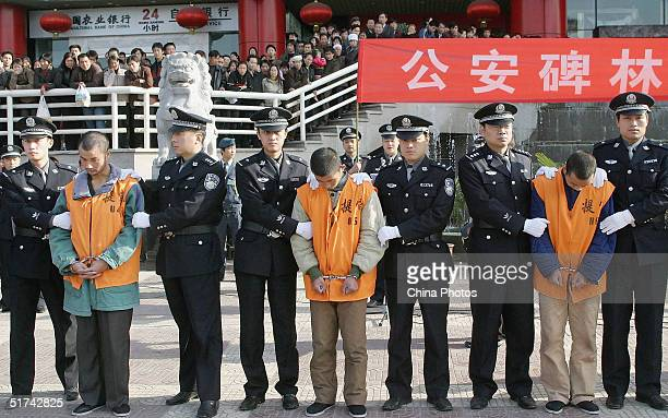 Chinese police parade a group of 15 convicted criminals to be sentenced in public most of which are likely to face the death penalty on November 15...