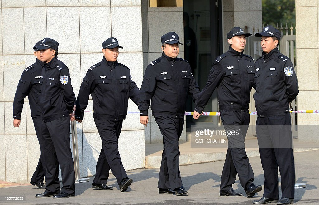 Chinese police patrol the gate of the Shandong high court building in Jinan, east China Shandong province on October 25, 2013. The court will deliver the ruling on the appeal of once-powerful politician Bo Xilai, formerly one of the country's top 25 leaders, who ran the southwestern megacity of Chongqing but was sentenced to life in prison in September by the Intermediate People's Court in Jinan.