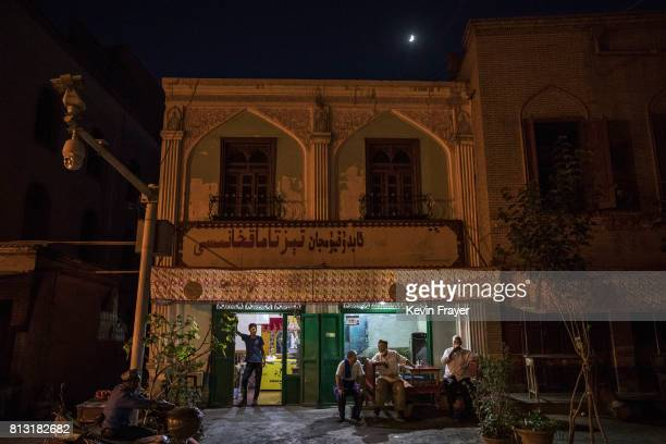 Chinese police security camera is seen outside an ethnic Uyghur restaurant on June 29 2017 in the old town of Kashgar in the far western Xinjiang...