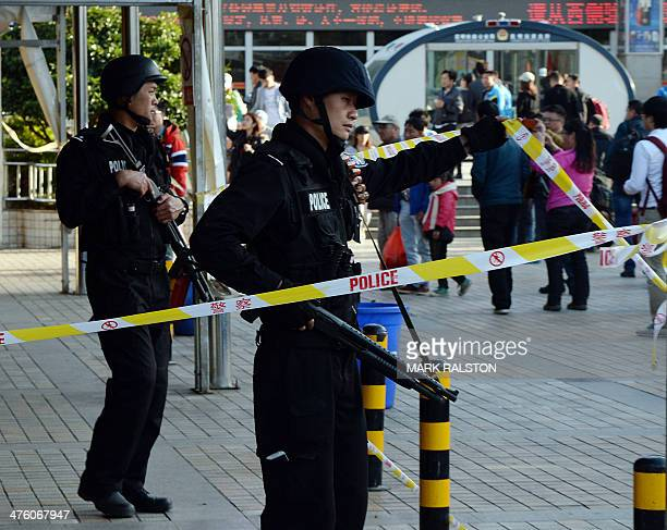 Chinese police stand guard at the scene of an attack at the main train station in Kunming Yunnan province on March 2 2014 Knifewielding assailants...