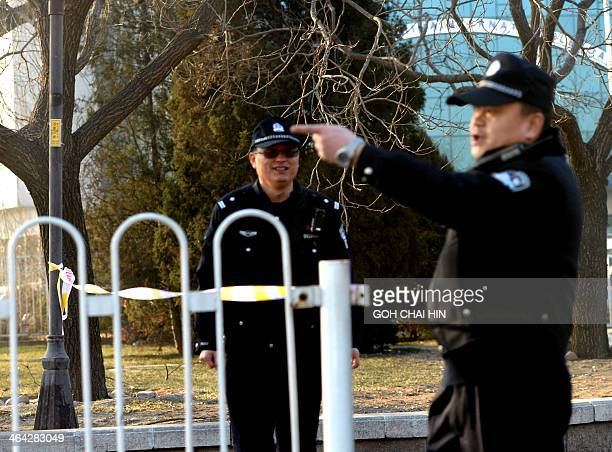 Chinese police stand guard in Beijing outside the No 1 Intermediate court on January 22 as strict security was imposed ahead of the trial of Xu...