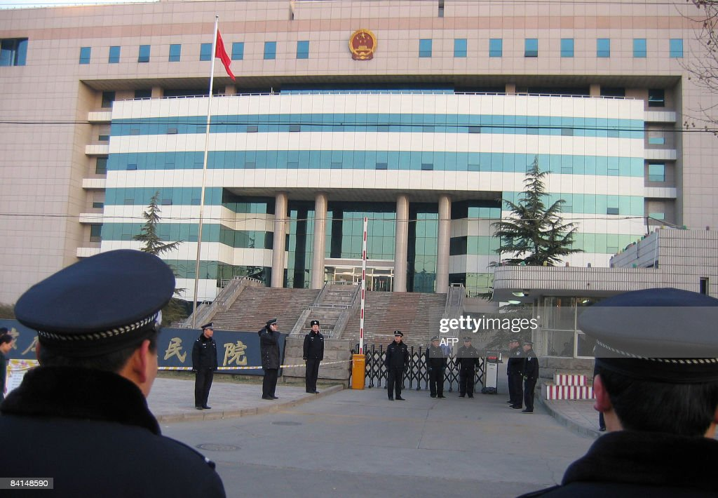 Chinese police surround a court building in Shijiazhuang Hebei province on December 31 as the trial of former head of the Sanlu Group Tian Wenhua...