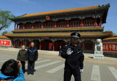 A Chinese policeman asks not to take pictures outside Zhongnanhai which serves as the central headquarters for the Communist Party of China after the...