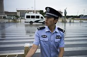 A Chinese policeman checks an entrance to Tiananmen Square in Beijing on September 1 prior to a military parade to be held on September 3 to mark the...