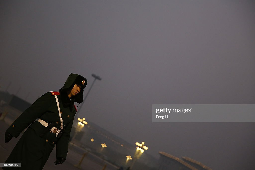 A Chinese policeman guards at the Tiananmen Square during dangerous levels of air pollution on January 13, 2013 in Beijing, China. Heavy smog shrouded Beijing with pollution at hazardous levels from January 12.