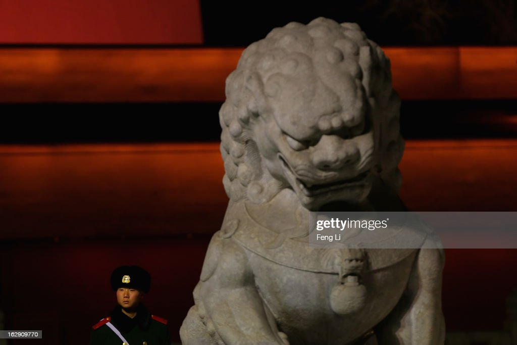 A Chinese policeman guards behind a stone lion in front of the Tiananmen Gate on March 1, 2013 in Beijing, China. The reshuffle will be completed at the first annual session of the 12th National People's Congress (NPC), which is scheduled to begin on March 5, and the first annual session of the 12th National Committee of the Chinese People's Political Consultative Conference (CPPCC), which will commence on March 3.