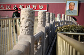 Chinese policeman guards in front of a giant portrait of the late chairman Mao Zedong on the Tiananmen Gate at Tiananmen Square on March 2 2015 in...
