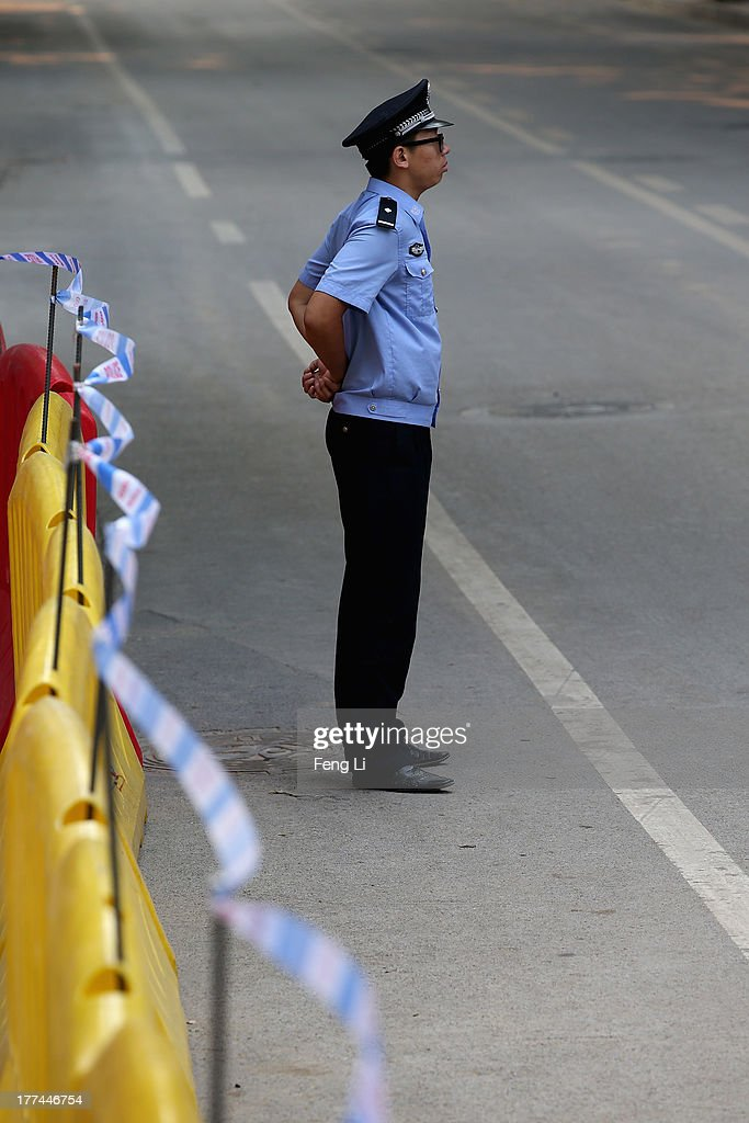 A Chinese policeman guards outside the Jinan Intermediate People's Court on August 23, 2013 in Jinan, China. Ousted Chinese politician Bo Xilai is standing trial on charges of bribery, corruption and abuse of power for a second straight day. Bo Xilai made global headlines last year when his wife Gu Kailai was charged and convicted of murdering British businessman Neil Heywood.