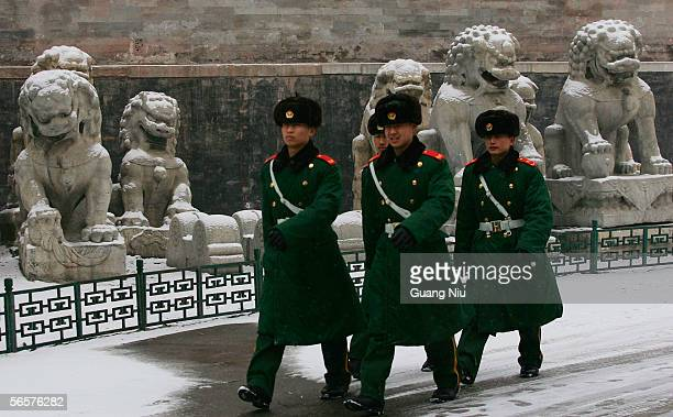 Chinese policeman patrol in the snow at Beijing's Forbidden City on January 12 2006 in Beijing China China is experiencing the coldest winter in 20...