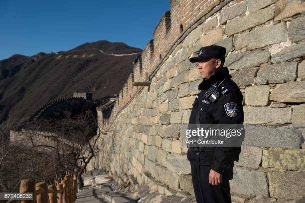A Chinese policeman secures an area ahead of the arrival of US First Lady Melania Trump on the Great Wall of China on the outskirts of Beijing on...