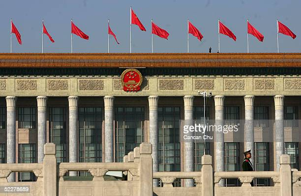 Chinese policeman stands guard outside the Great Hall of the People before the opening ceremony of the National People's Congress or parliament on...