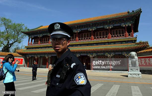 A Chinese policeman stands guard outside Zhongnanhai which serves as the central headquarters for the Communist Party of China after the sacking of...