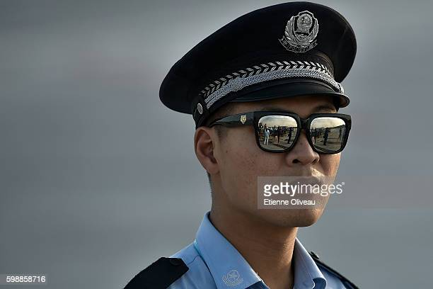 Chinese policeman stands on the tarmac at the Hangzhou Xiaoshan International Airport on September 3 2016 in Hangzhou China
